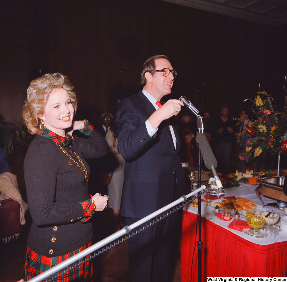 "[""Senator John D. (Jay) Rockefeller, accompanied by his wife Sharon, speaks at a banquet event following his Senate Swearing-In Ceremony.""]%"