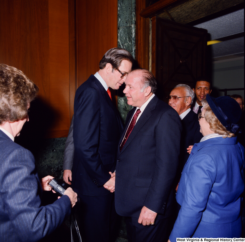 "[""Senator John D. (Jay) Rockefeller shakes the hand of an unidentified individual at the Senate Swearing-In Ceremony.""]%"