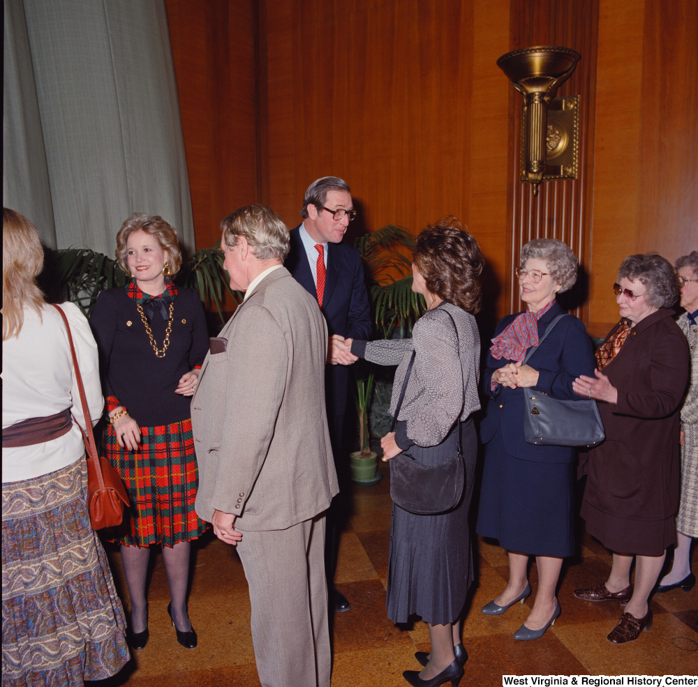 "[""Unidentified supporters greet Senator John D. (Jay) Rockefeller following his Senate Swearing-In Ceremony.""]%"