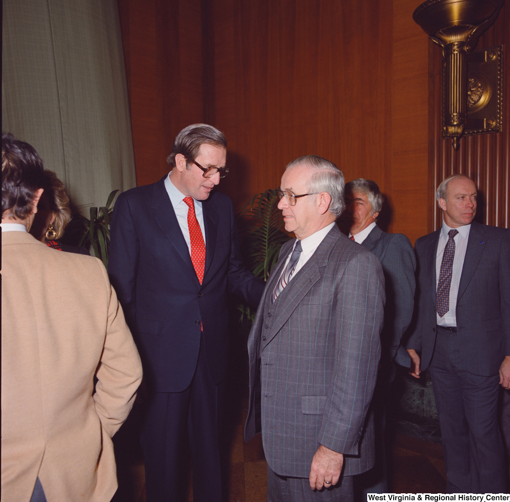 "[""An unidentified supporter speaks with Senator John D. (Jay) Rockefeller after the Senate Swearing-In Ceremony.""]%"