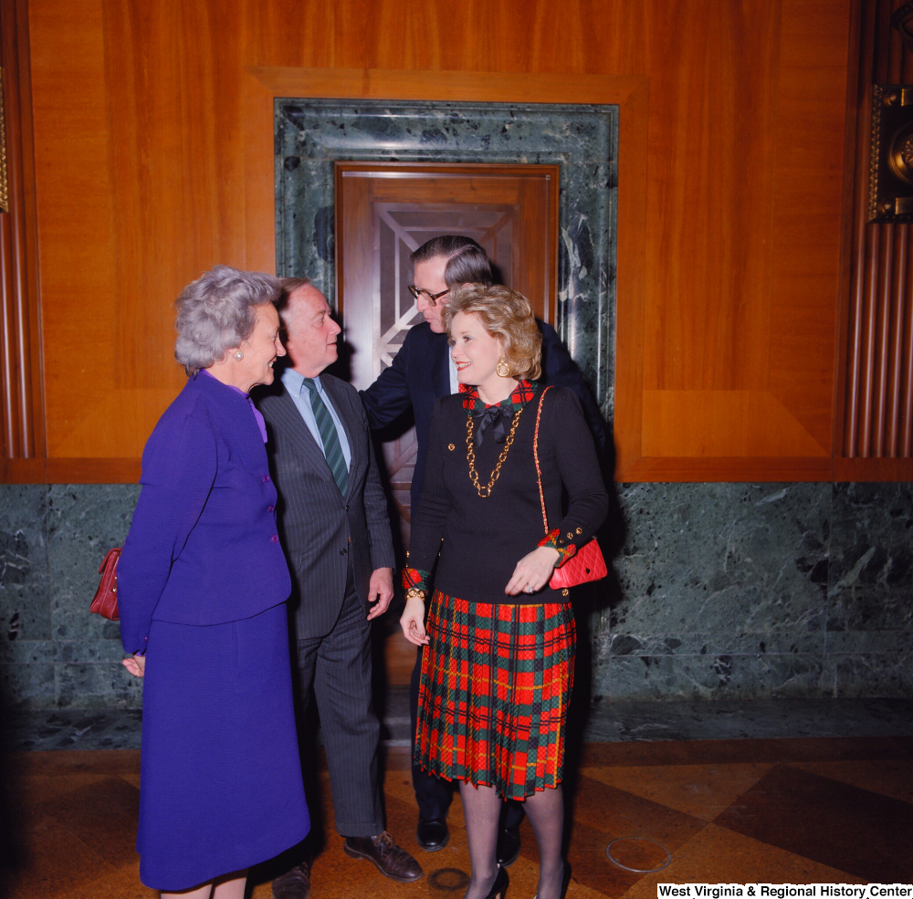 "[""Senator John D. (Jay) Rockefeller and his wife Sharon greet two unidentified individuals at the Senate Swearing-In Ceremony.""]%"