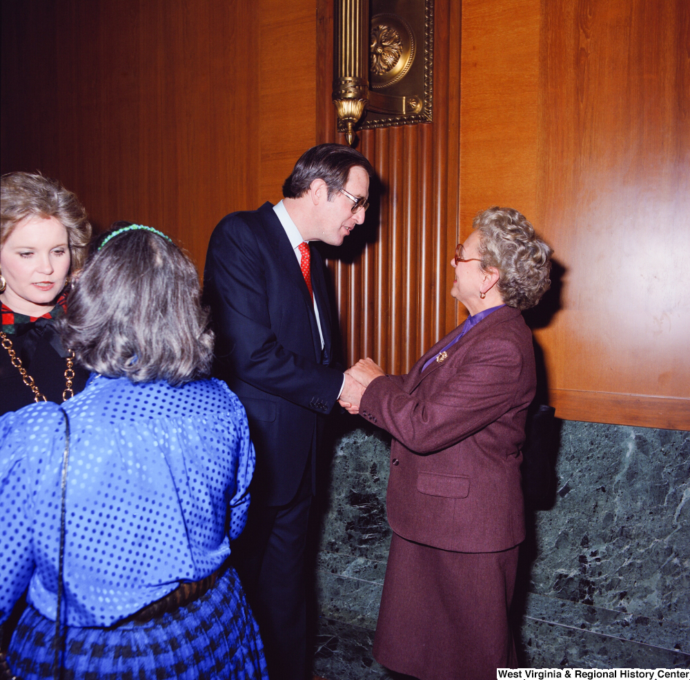 "[""Senator John D. (Jay) Rockefeller and his wife Sharon greet and shake hands with two supporters at the Senate Swearing-In Ceremony.""]%"