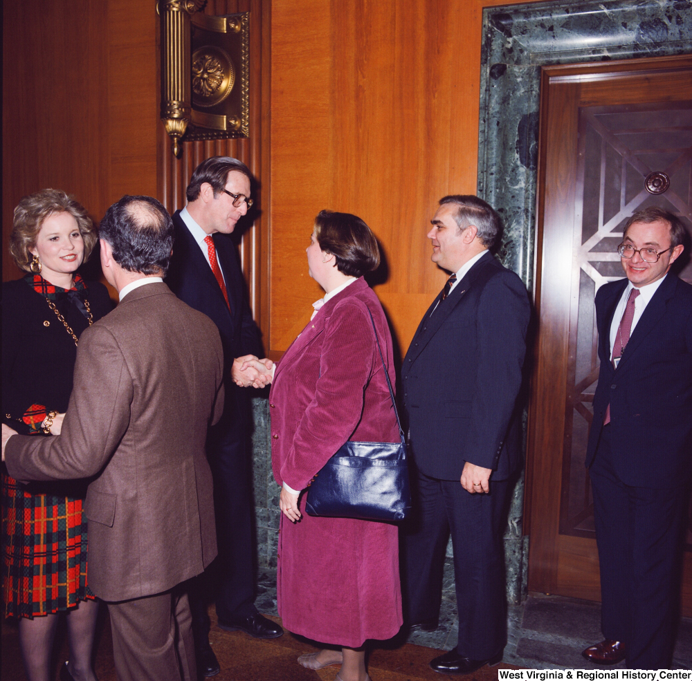 "[""A group of unidentified supporters are greeted by Senator John D. (Jay) Rockefeller and his wife Sharon at the Senate Swearing-In Ceremony.""]%"