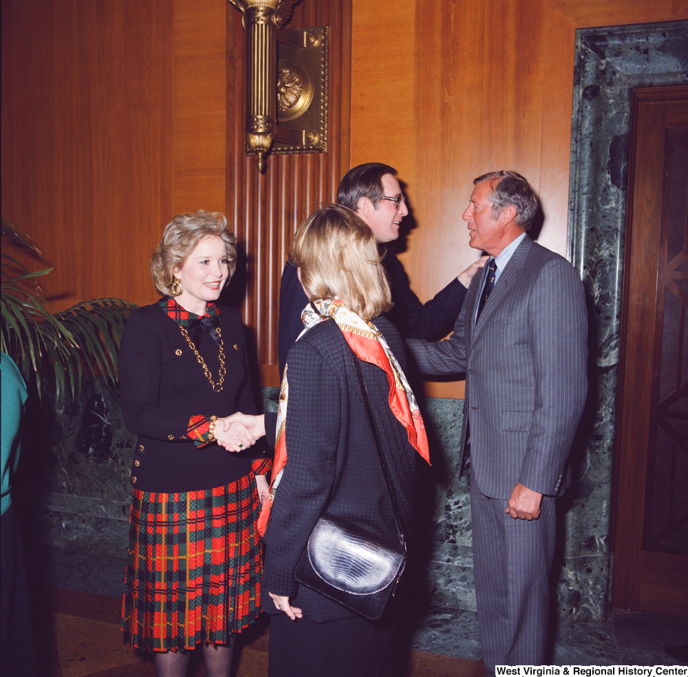 "[""Sharon Rockefeller and Senator John D. (Jay) Rockefeller greet two unidentified supporters at the Senate Swearing-In Ceremony.""]%"