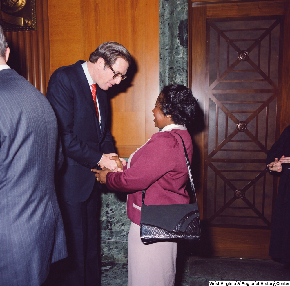 "[""An unidentified supporter shakes hands with Senator John D. (Jay) Rockefeller after he is sworn into office at the Senate Swearing-In Ceremony.""]%"