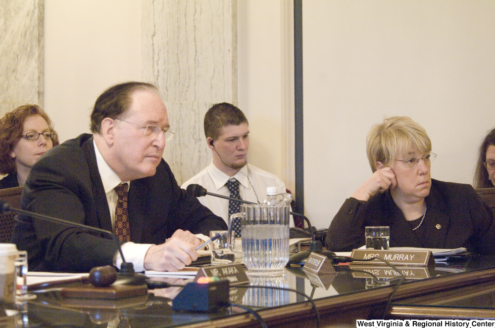 "[""Senator John D. (Jay) Rockefeller and Senator Patty Murray listen to testimony during an Intelligence Committee hearing.""]%"