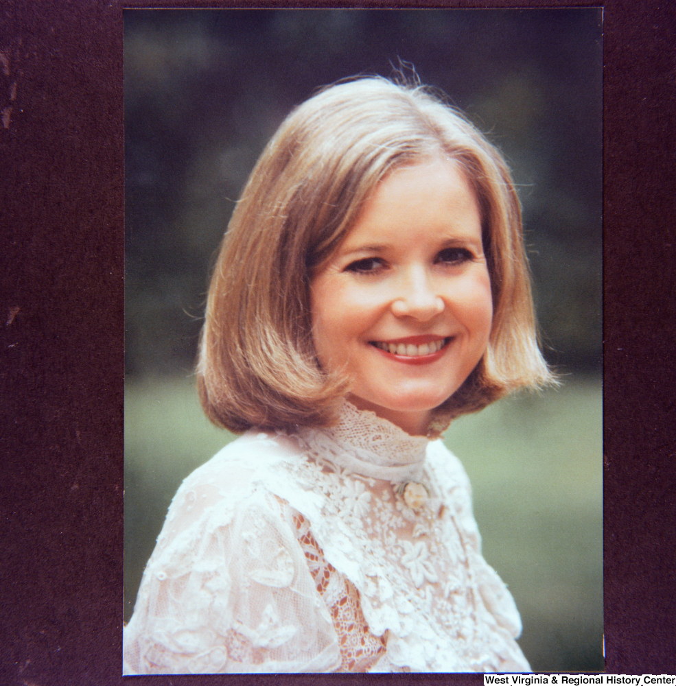 "[""This image is of a photograph of a portrait of Sharon Rockefeller.""]%"