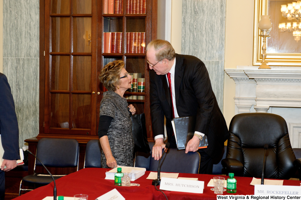 "[""Senators John D. (Jay) Rockefeller and Barbara Boxer talk before a hearing.""]%"