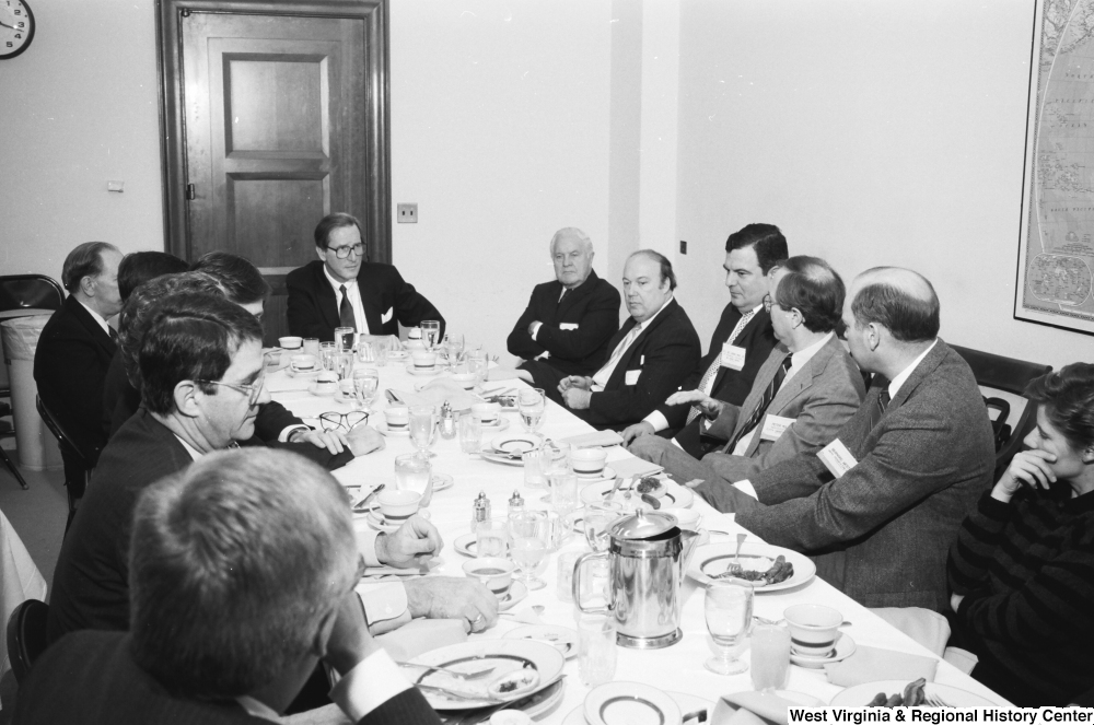 "[""Senator John D. (Jay) Rockefeller sits and listens to someone speak during a breakfast with representatives from West Virginia hospitals.""]%"
