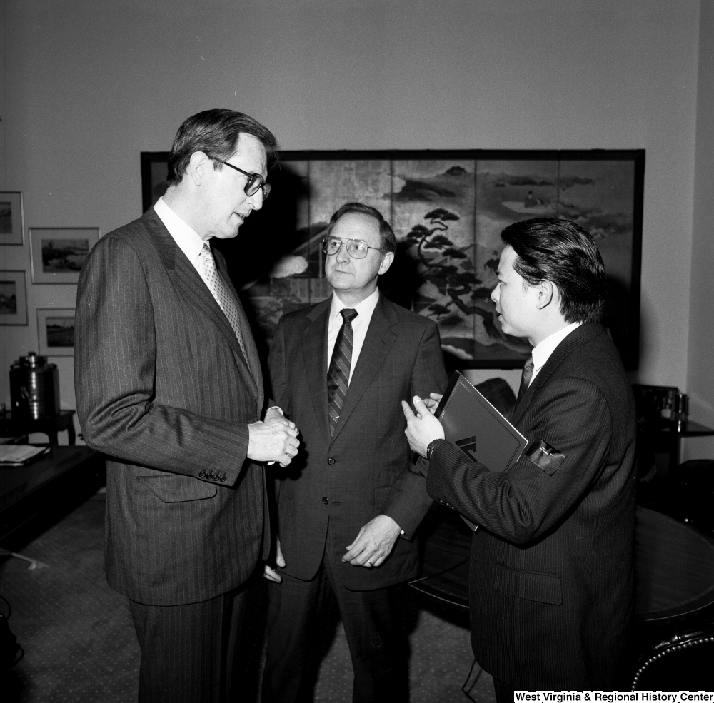 "[""Senator John D. (Jay) Rockefeller speaks with a representative from China Steel and a representative from the Island Creek Coal Company.""]%"