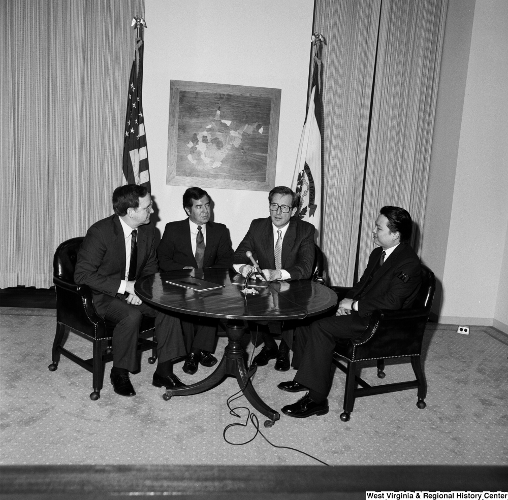 "[""Senator John D. (Jay) Rockefeller sits around a table and speaks with Congressman Nick Rahall and two representatives from China Steel and the Island Creek Coal Company.""]%"