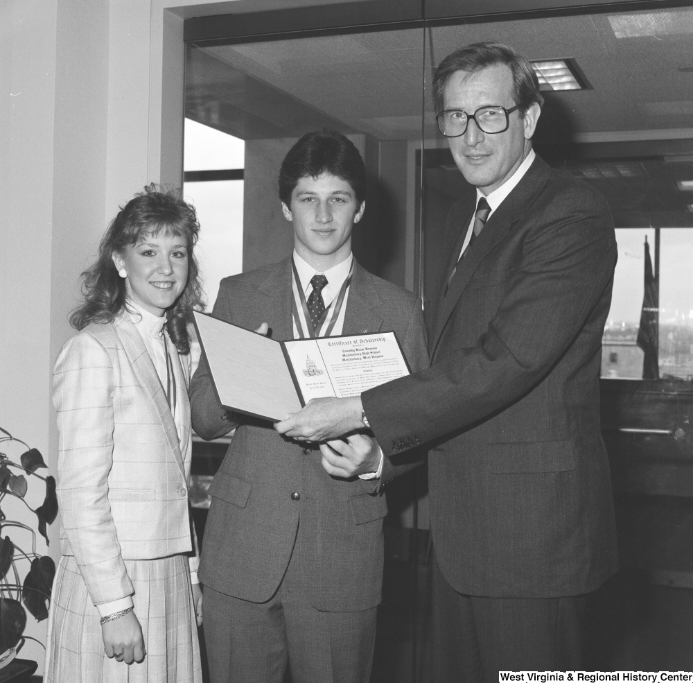 "[""Senator John D. (Jay) Rockefeller stands with the two West Virginia representatives in the United States Senate Youth Program.""]%"