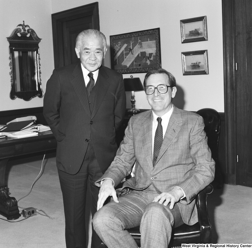 "[""Senator John D. (Jay) Rockefeller sits and smiles with an unidentified guest in his office.""]%"