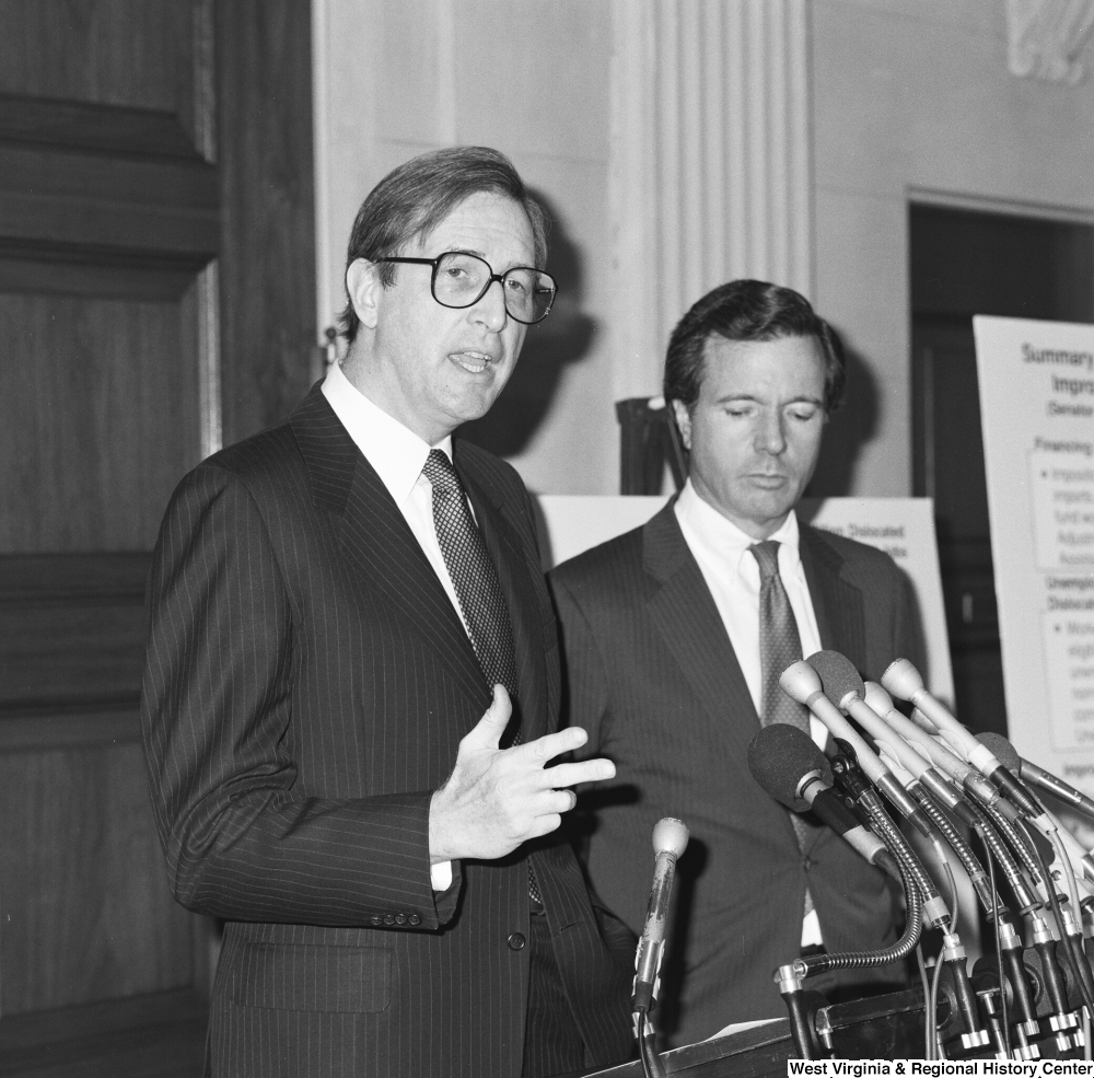 "[""Senator H. John Heinz III stands beside Senator John D. (Jay) Rockefeller as he speaks about the Dislocated Workers Improvement Act of 1987 at a press event.""]%"