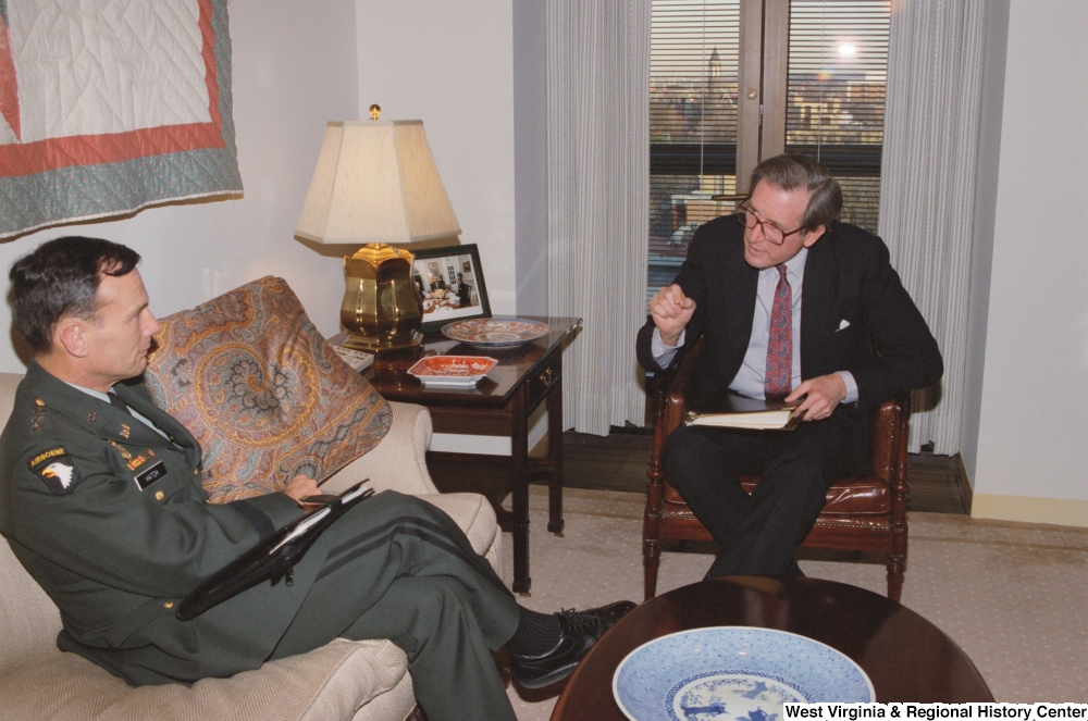 "[""Senator John D. (Jay) Rockefeller sits in his office and speaks with General Hatch of the Army Corps of Engineers.""]%"