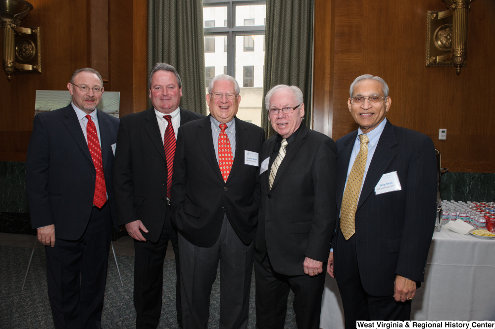 "[""Five industry leaders stand together at a Welcome to Washington luncheon event.""]%"