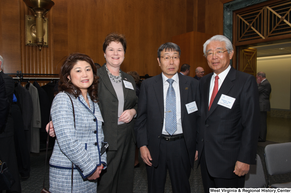 "[""Four industry leaders stand together at a Welcome to Washington luncheon.""]%"