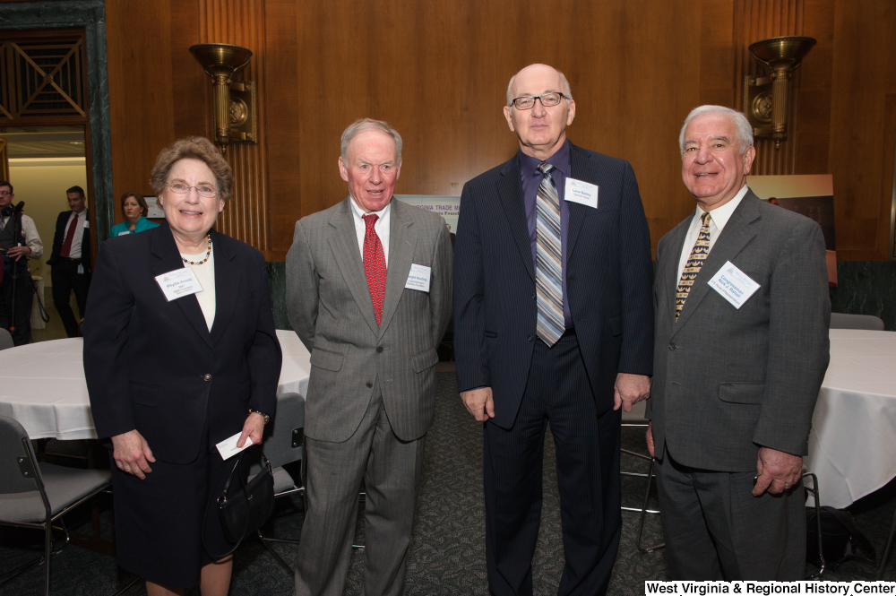 "[""Representative Nick Rahall stands with three individuals at a Welcome to Washington luncheon event.""]%"