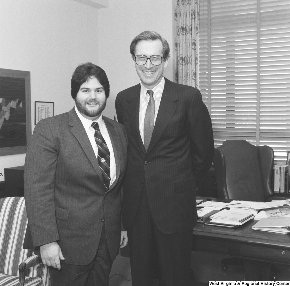 "[""Senator John D. (Jay) Rockefeller stands with a man from National Home Study in his office.""]%"