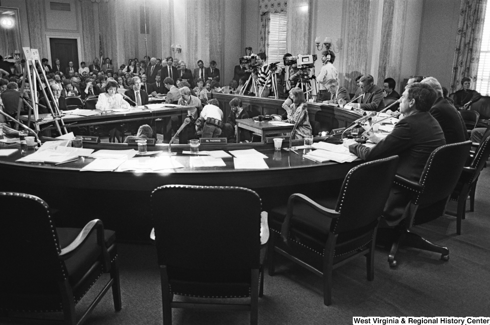 "[""In this photograph, a Senate Commerce Committee hearing is taking place.""]%"