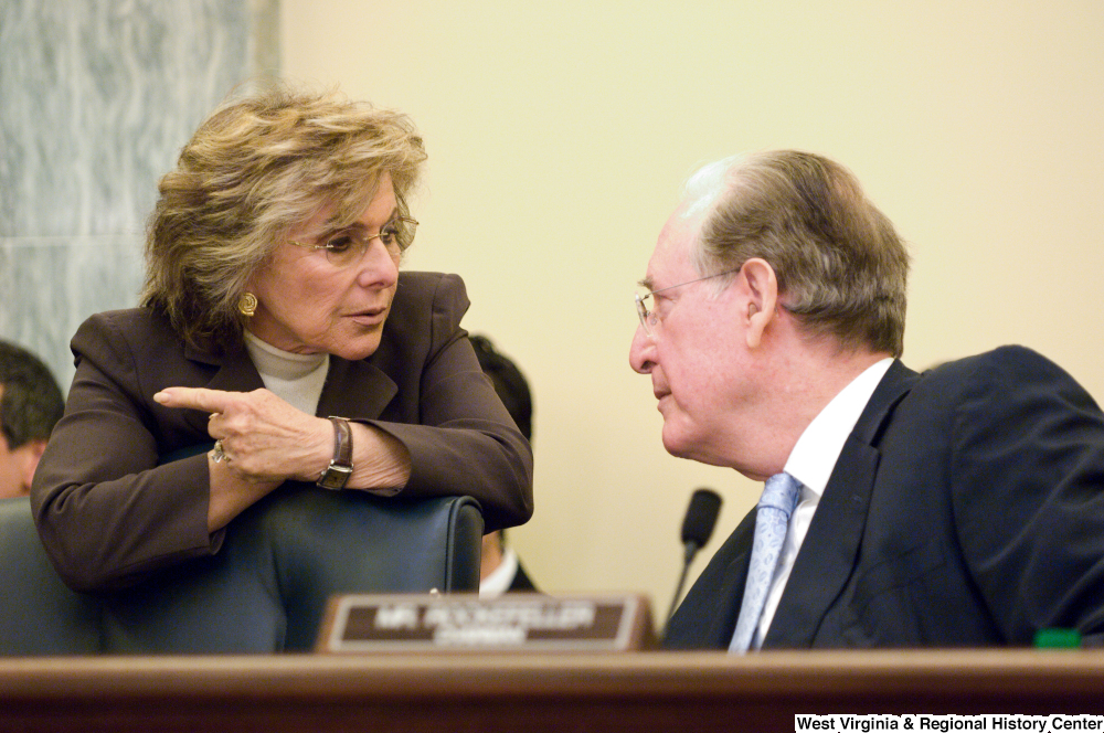 "[""Senator John D. (Jay) Rockefeller and Senator Barbara Boxer speak before a Commerce Committee hearing.""]%"