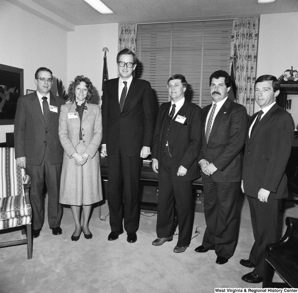 "[""Senator John D. (Jay) Rockefeller stands for a photograph with five representatives from the West Virginia Vocational Administration in his Washington office.""]%"