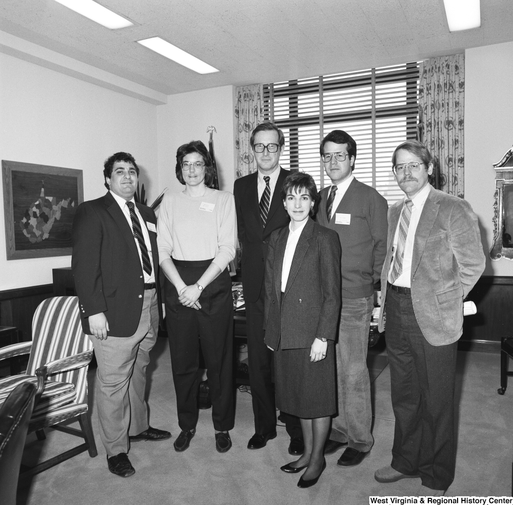 "[""Senator John D. (Jay) Rockefeller stands in his office for a photograph with an unidentified group.""]%"