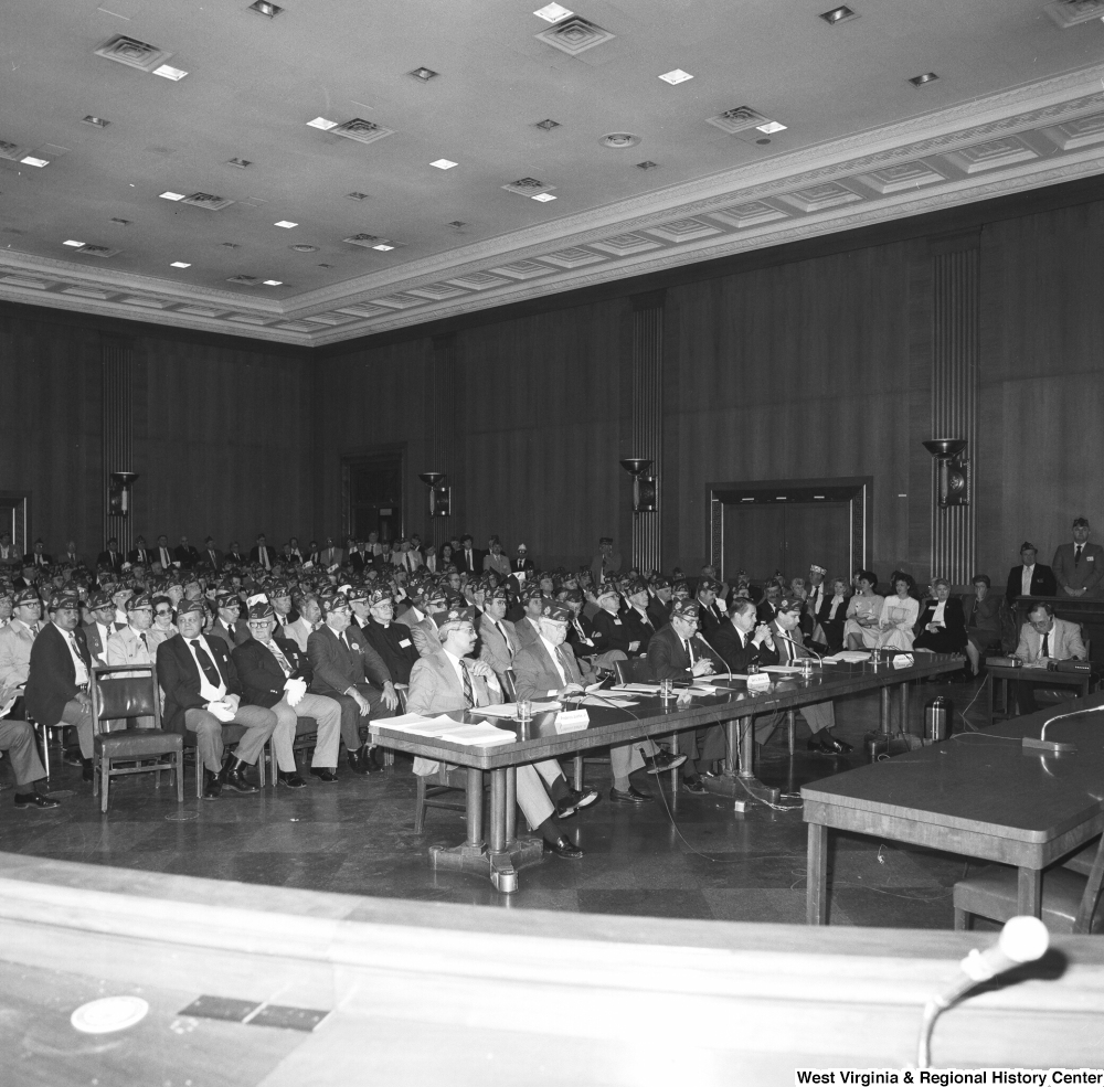"[""This photograph shows the audience at a Senate committee hearing.""]%"