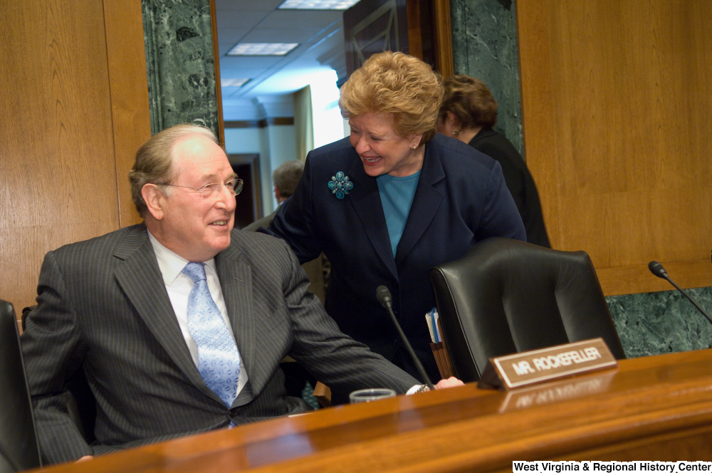 "[""Senators John D. (Jay) Rockefeller and Debbie Stabenow laugh together before a Senate Finance Committee hearing.""]%"