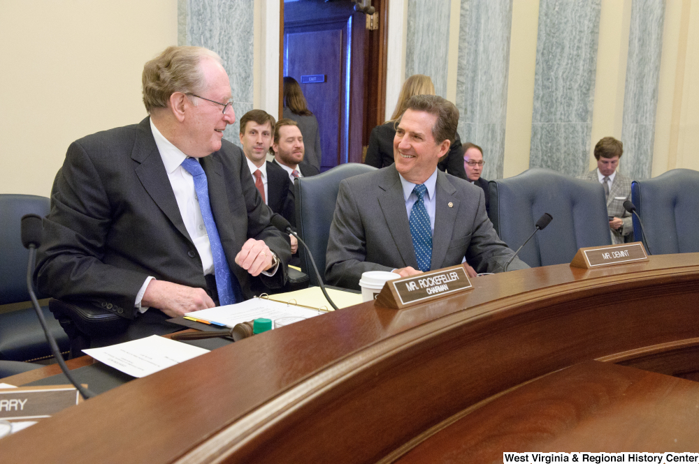 "[""Senators John D. (Jay) Rockefeller and Jim DeMint laugh together before a Commerce Committee hearing.""]%"