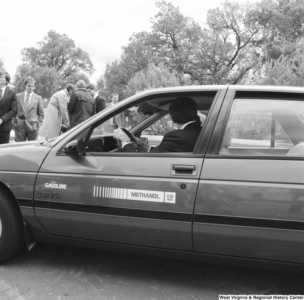 "[""Senator John D. (Jay) Rockefeller drives a GM gasoline/methanol car outside the Senate.""]%"
