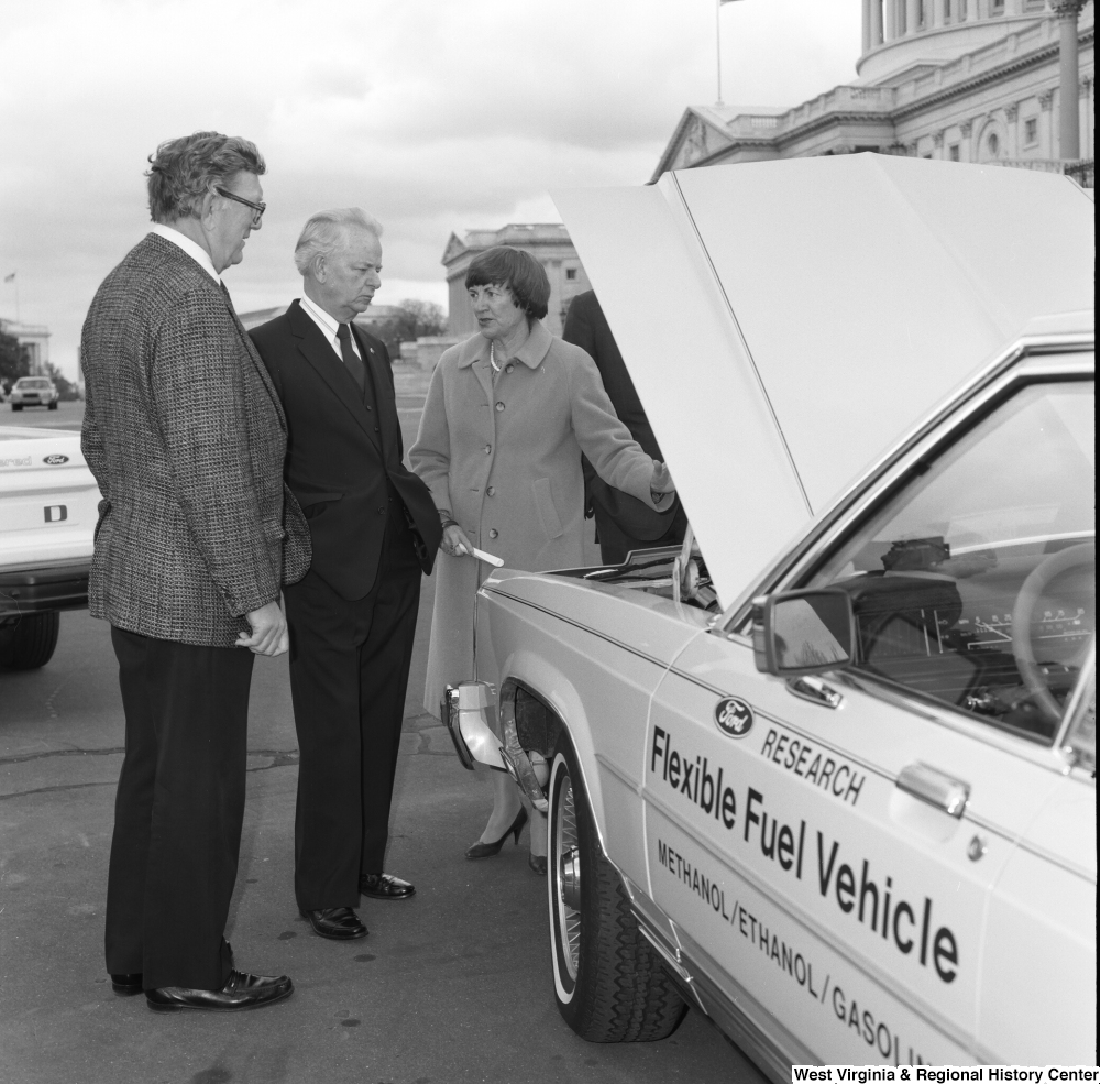 "[""Senator Robert C. Byrd looks at the engine of a Ford Flexible Fuel Vehicle.""]%"