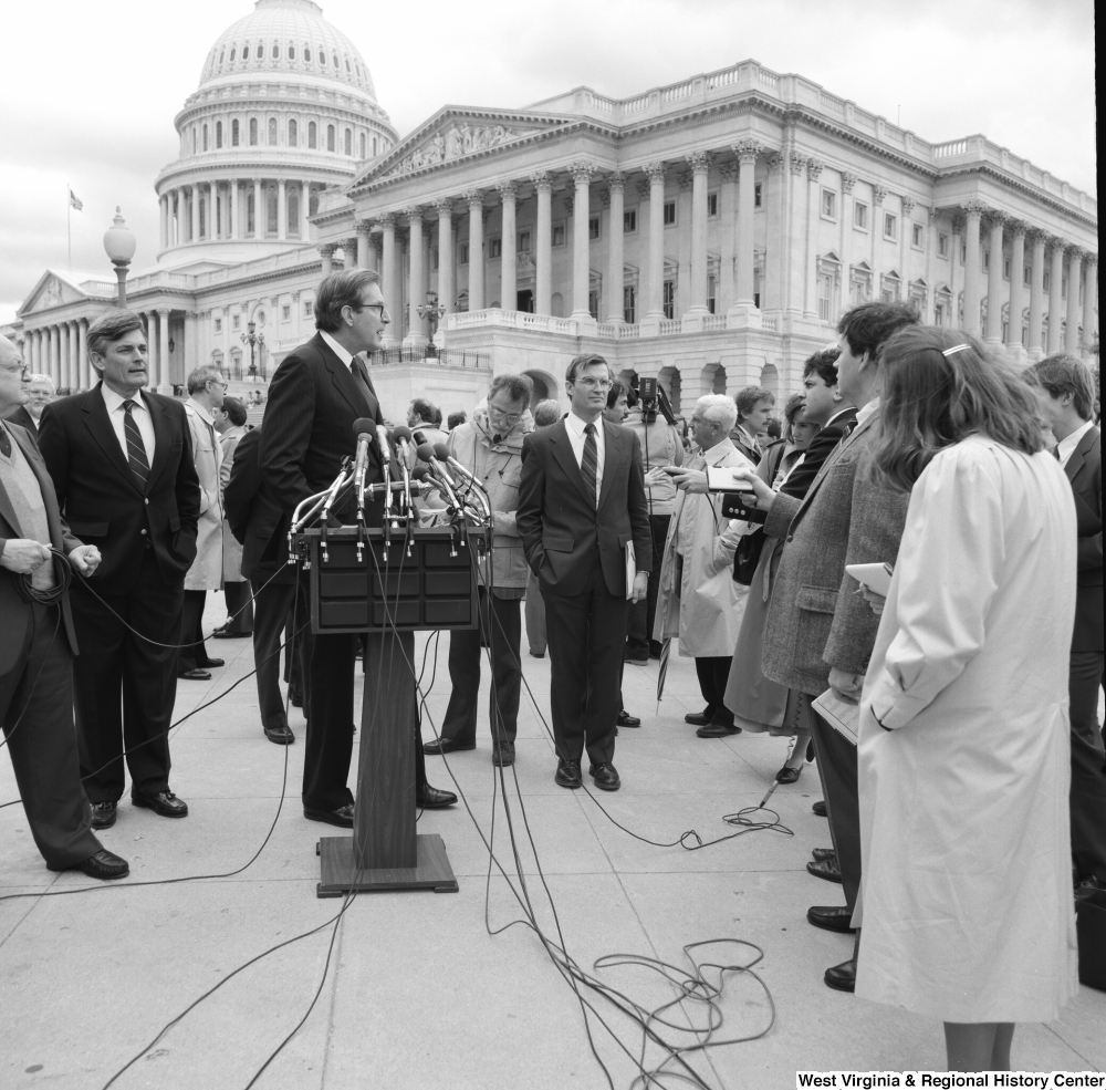 "[""Senator John D. (Jay) Rockefeller answers questions at an alternative motor fuels event outside the Senate.""]%"