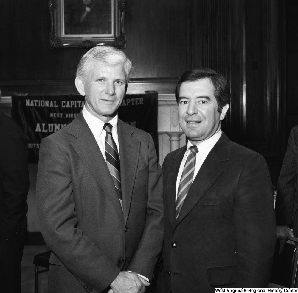 "[""West Virginia University President Neil S. Bucklew and Congressman Nick Rahall stand for a photograph at a WVU Alumni Association event in Washington.""]%"