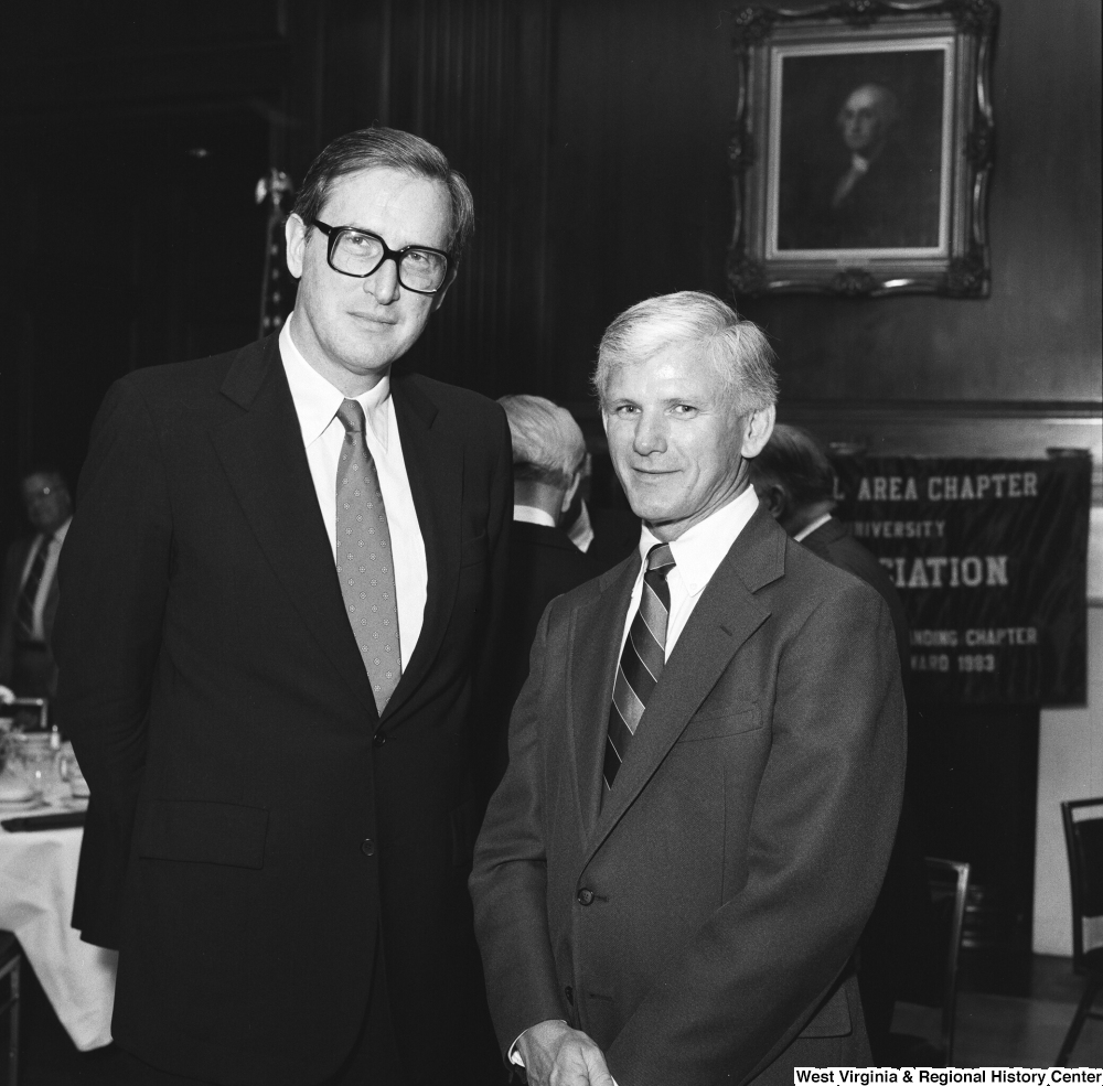 "[""Senator John D. (Jay) Rockefeller stands for a photograph with WVU President Neil S. Bucklew at a West Virginia University Alumni Association event in Washington.""]%"