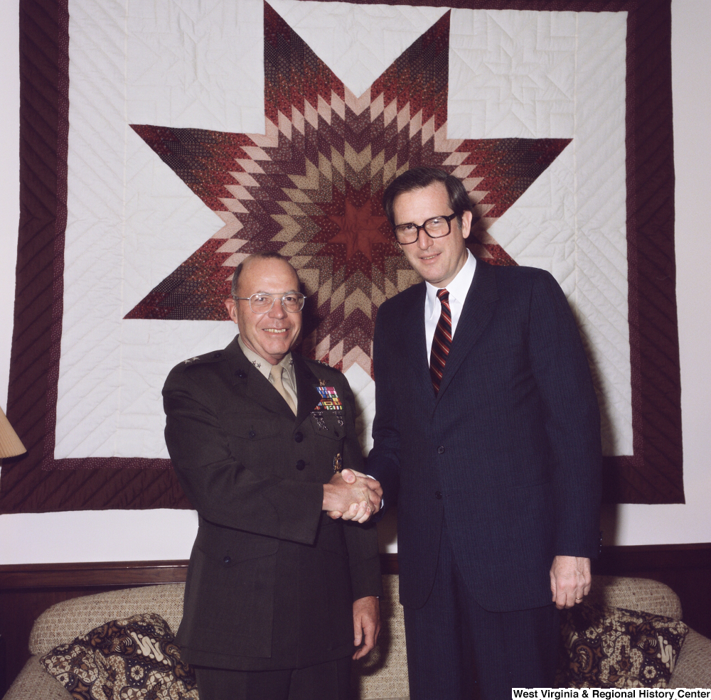 "[""Senator John D. (Jay) Rockefeller and retiring Major General Gregory A. Corliss shake hands and pose for a photograph in the Senator's Washington office.""]%"