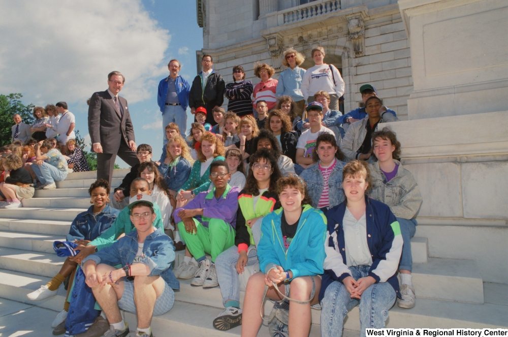 "[""Senator John D. (Jay) Rockefeller stands on the steps of the Senate with students from West Virginia.""]%"