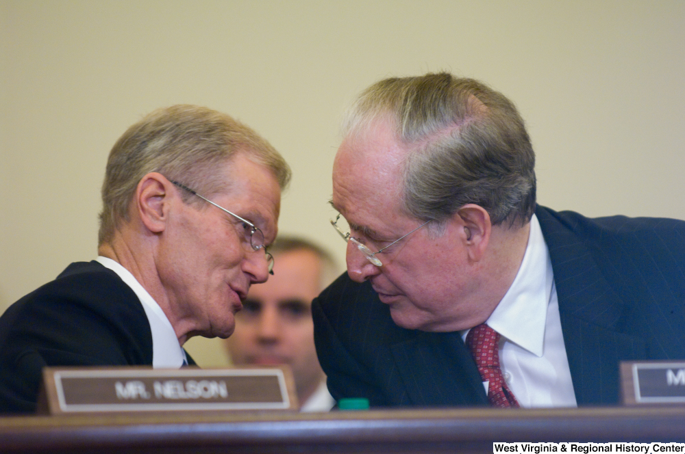 "[""Senator John D. (Jay) Rockefeller and Senator Bill Nelson talk during a Commerce Committee hearing.""]%"