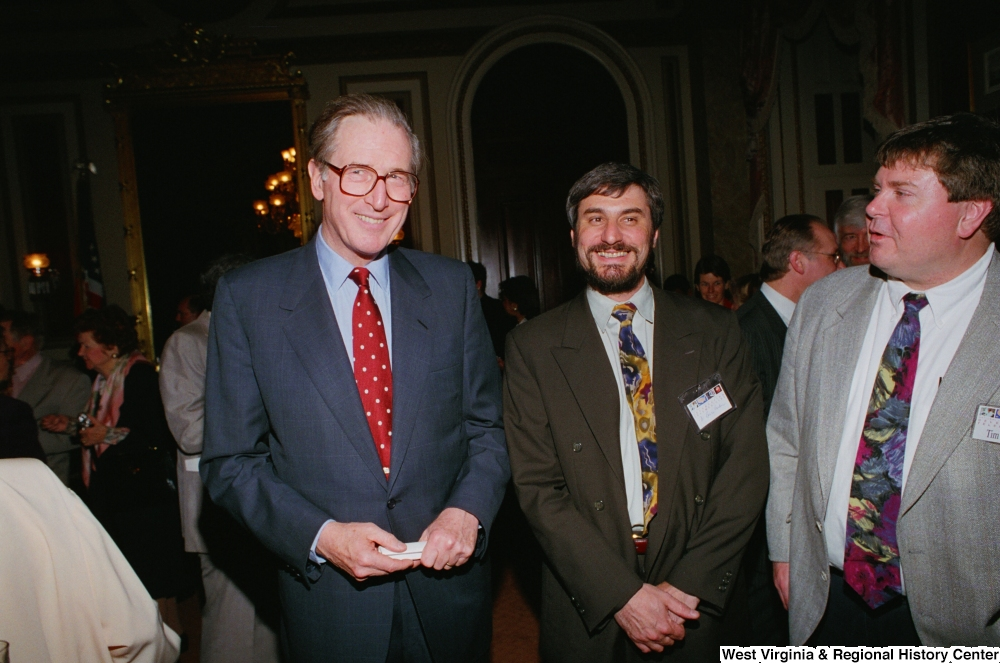 "[""Senator John D. (Jay) Rockefeller stands for a photo with two healthcare professionals during a Celebrating Telemedicine conference.""]%"