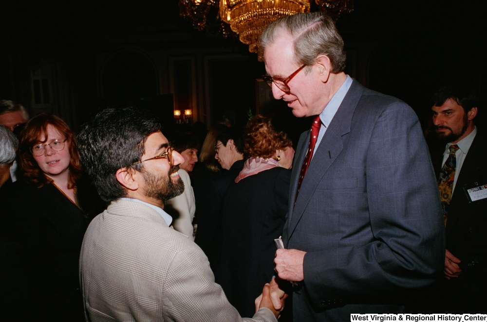 "[""Senator John D. (Jay) Rockefeller shakes hands with an unidentified man at the Celebrating Telemedicine conference.""]%"