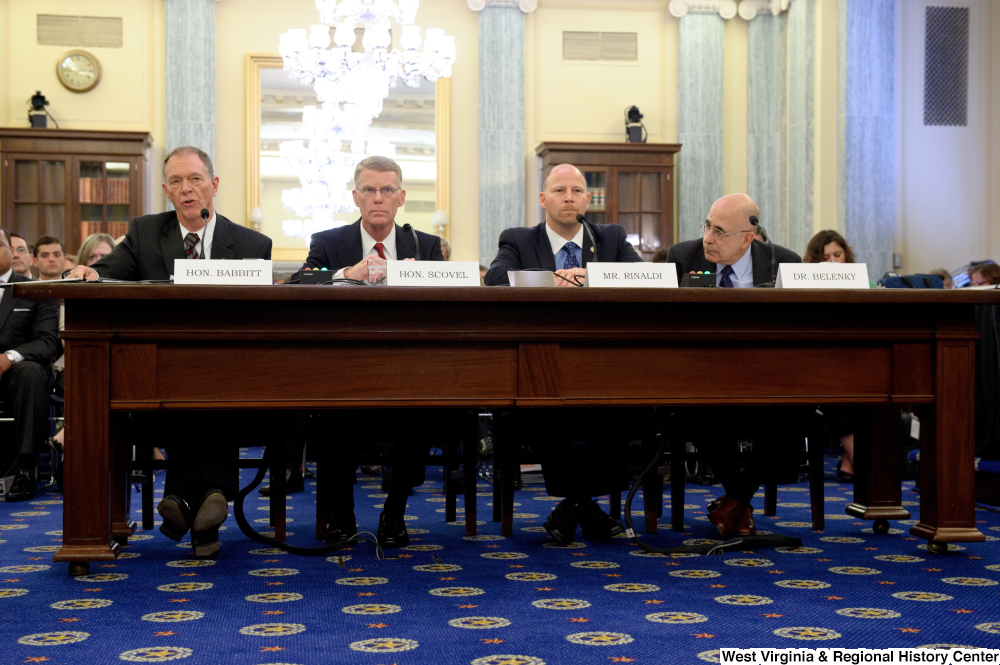 "[""Four men sit at a table and testify before a Senate Commerce Committee hearing.""]%"