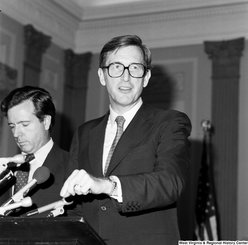 "[""Senator John D. (Jay) Rockefeller smiles at his audience as he speaks about the Dislocated Workers Improvement Act. His cosponsor, Senator John Heinz, stands behind him.""]%"