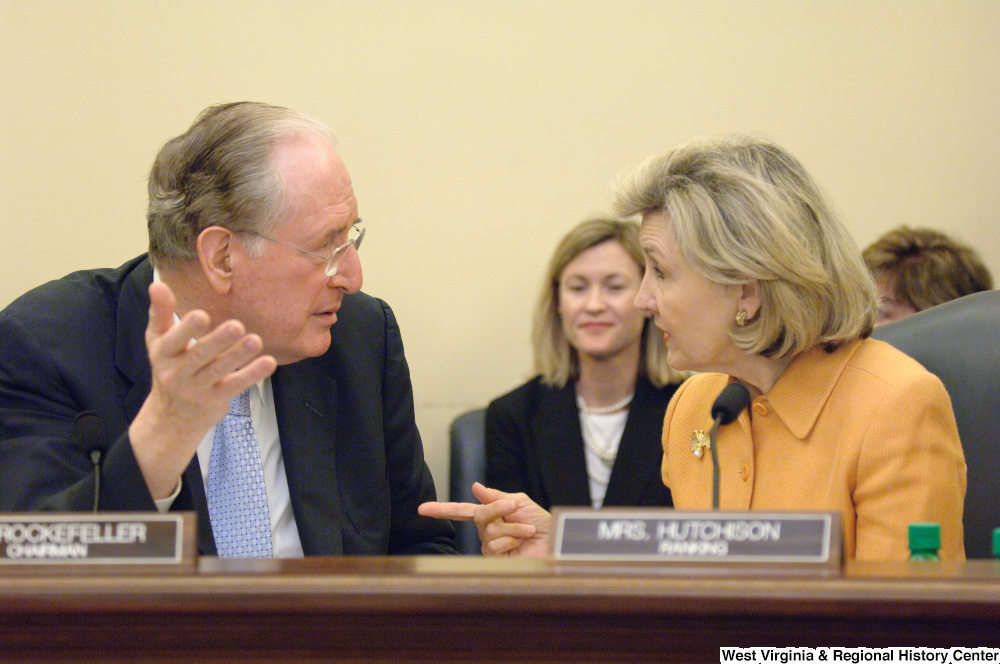 "[""Senator John D. (Jay) Rockefeller and Kay Hutchison speak during a Commerce Committee hearing.""]%"