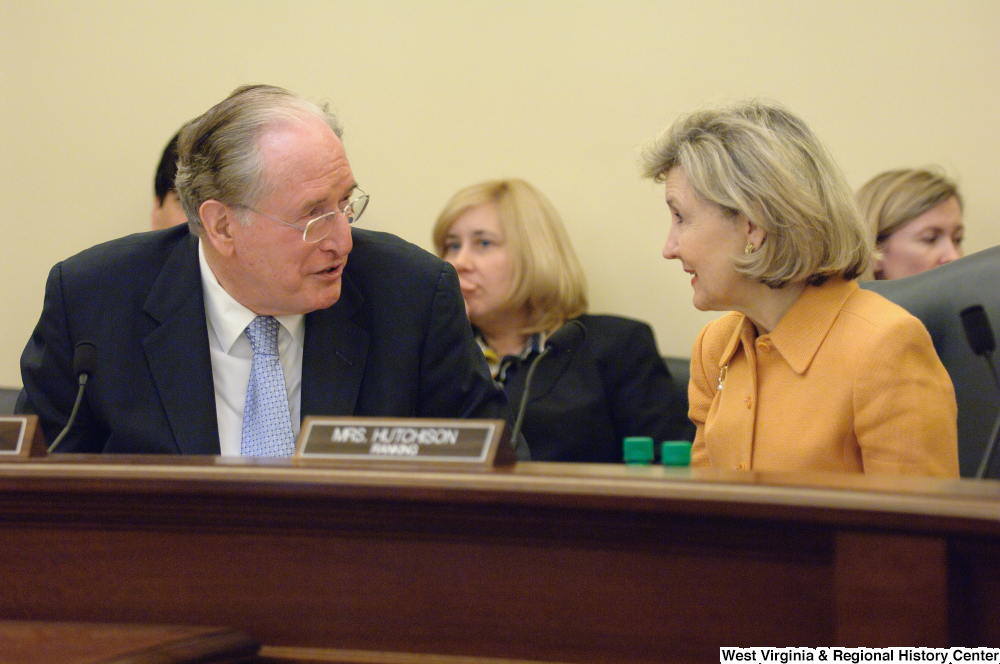 "[""Senators Kay Hutchison and John D. (Jay) Rockefeller talk during a Commerce Committee hearing.""]%"