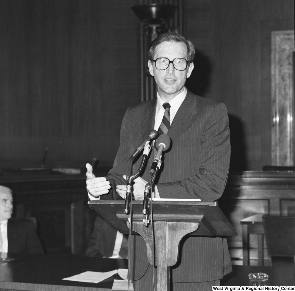 "[""Senator John D. (Jay) Rockefeller gestures with his hands as he speaks at a press event for the Veterans Affairs Committee.""]%"
