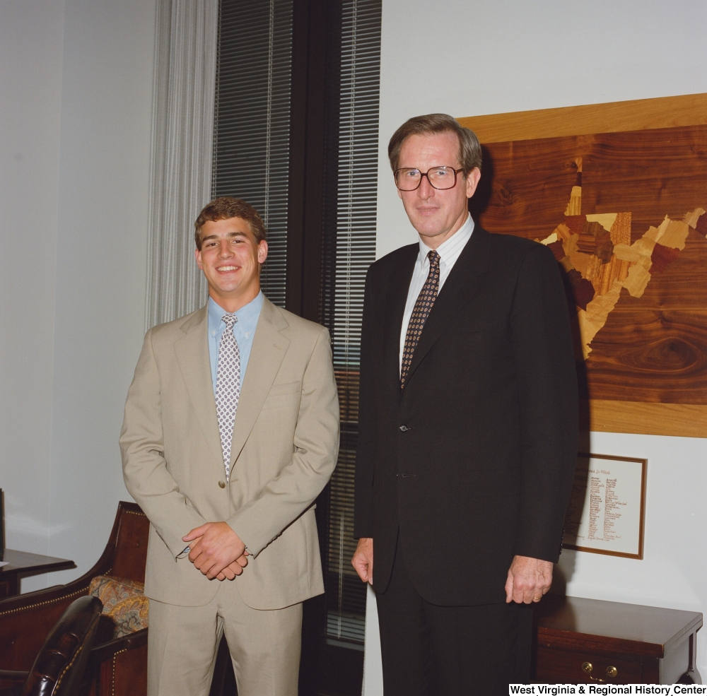 "[""Senator John D. (Jay) Rockefeller stands next to an unidentified young man in his office.""]%"