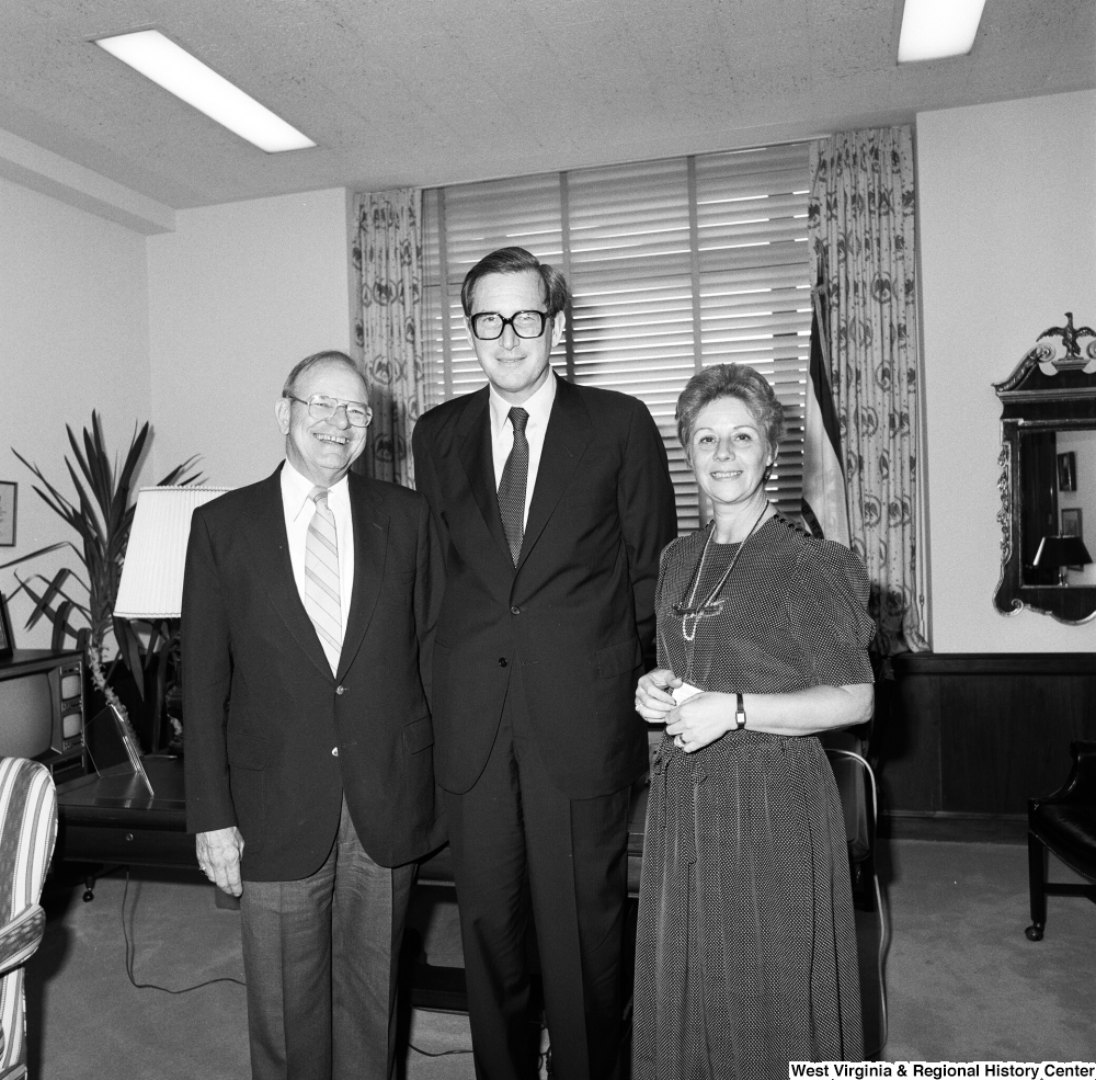 "[""Senator John D. (Jay) Rockefeller stands for a photograph with two unidentified individuals in his Washington office.""]%"