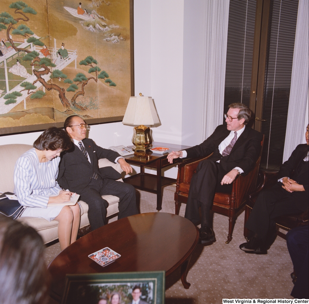"[""Senator John D. (Jay) Rockefeller sits with a representative from the Japanese Embassy.""]%"