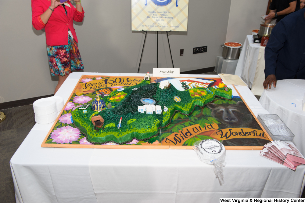 "[""A large birthday cake celebrates the 150th anniversary of West Virginia's statehood.""]%"