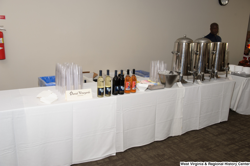 "[""A table sits for Daniel Vineyards at the 150th birthday celebration for West Virginia.""]%"
